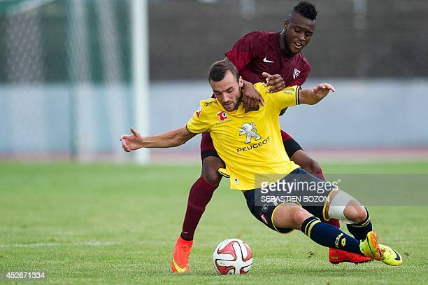 Sochaux' French midfielder Florin Berenguer vies for the ball with Metz' French midfielder Cheick Doukoure during the friendly football match Sochaux...