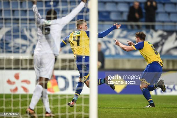 FC Sochaux' French midfielder Jean Ruiz celebrates after scoring a goal during the French Cup football match between Sochaux vs Amiens at the Auguste...