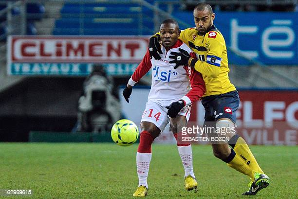 Sochaux' Malian defender Cedric Kante vies with Nancy's Cameroonian forward Paul Alo'o Efoulou during their French L1 football match Sochaux versus...