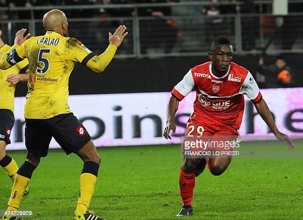 Sochaux's Brazilian midfielder Carlos Alberto Carlao reacts as Valenciennes' Ghanaian forward Majeed Waris celebrates after scoring a goal during the...
