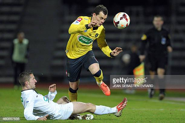 Sochaux's French defender Julien Faussurier vies with Bressuire's defender Quentin Brebion during the French Cup football match between Bressuire and...