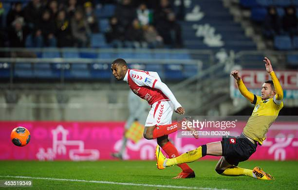 Sochaux's French defender Mathieu Peybernes fails to stop Reims' French defender Christopher Glombard from scoring a goal during the French L1...