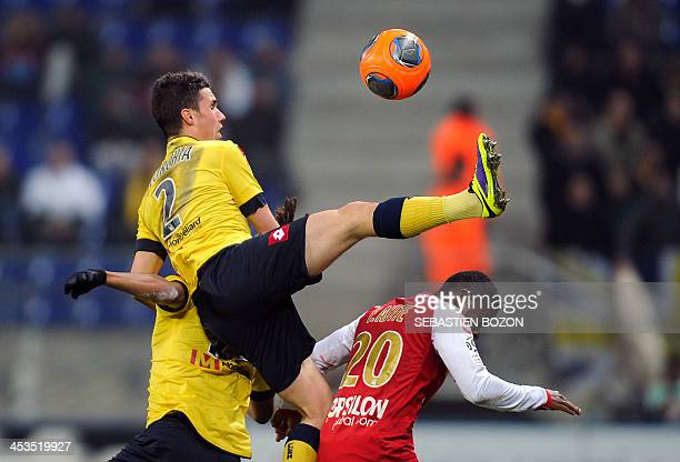 Sochaux's French defender Sebastien Corchia kicks the ball over Reims' Togolese forward Floyd Ayite during the French L1 football match between...
