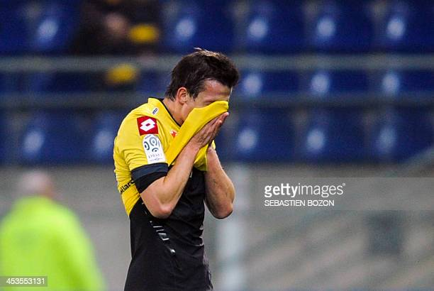 Sochaux's French forward Edouard Butin reacts at the end of the French L1 football match between Sochaux and Reims at the Auguste Bonal Stadium in...