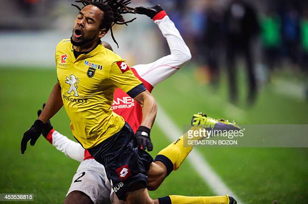 Sochaux's French forward Roy Contout is fouled by Reims' Malian defender Mohamed Fofana during the French L1 football match between Sochaux and Reims...