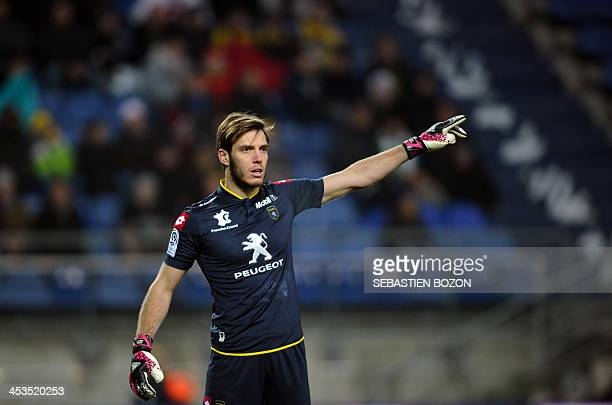 Sochaux's French goalkeeper Simon Pouplin gestures during the French L1 football match between Sochaux and Reims at the Auguste Bonal Stadium in...