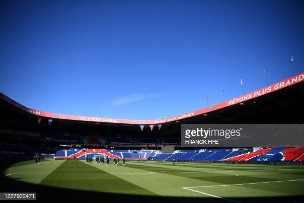 Sochaux's players walk on the pitch ahead of the French L1 pre-season friendly football match between Paris Saint-Germain and Sochaux at the Parc des...