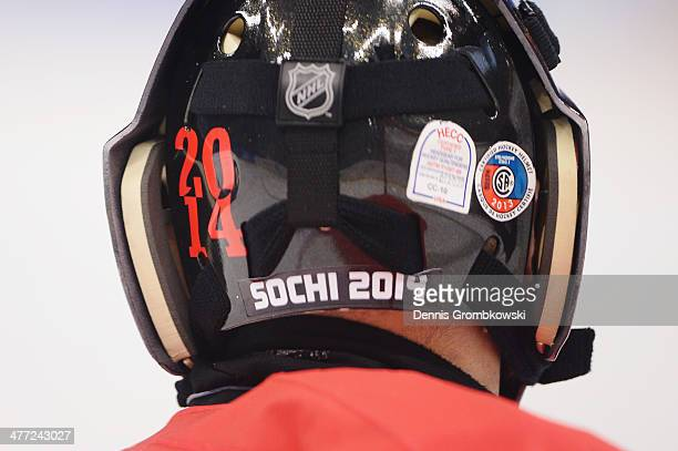 'Sochi 2014' is seen on the helmet of Canada's goalkeeper Benoit StAmand during the Preliminary Round Group A match between Canada and Sweden at...