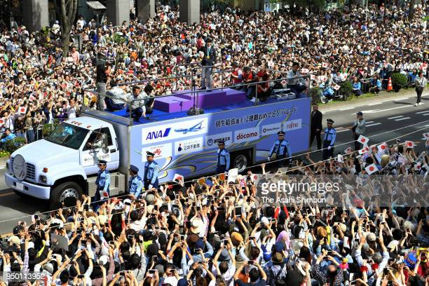 Sochi and PyeongChang Winter Olympic Games Figure Skating Men's Single gold medalist Yuzuru Hanyu waves to supporters during the parade on April 22...