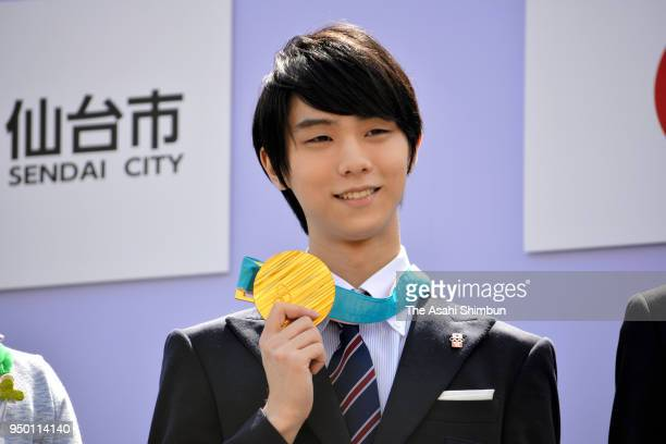 Sochi and PyeongChang Winter Olympic Games Figure Skating Men's Single gold medalist Yuzuru Hanyu poses for photographs during the parade on April 22...
