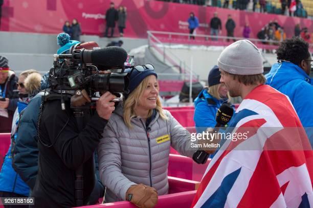 Sochi Bronze medalist Jenny Jones interviews Billy Morgan Great Britain BRONZE for the BBC following the men's snowboard big air flower ceremony at...