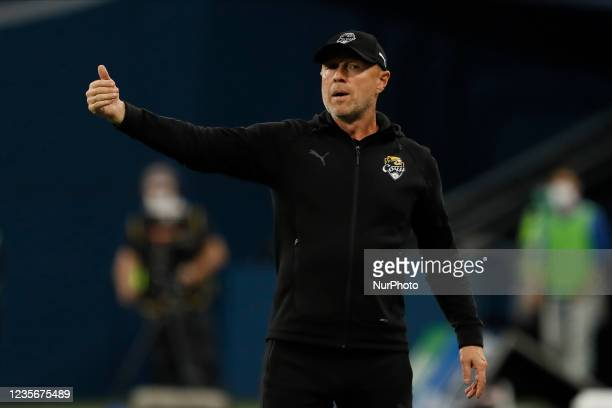 Sochi head coach Vladimir Fedotov gestures during the Russian Premier League match between FC Zenit Saint Petersburg and FC Sochi on October 3, 2021...