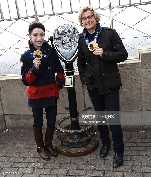 Sochi Olympic Gold Medalist Champions Charlie White and Meryl Davis visit The Empire State Building on February 27 2014 in New York City