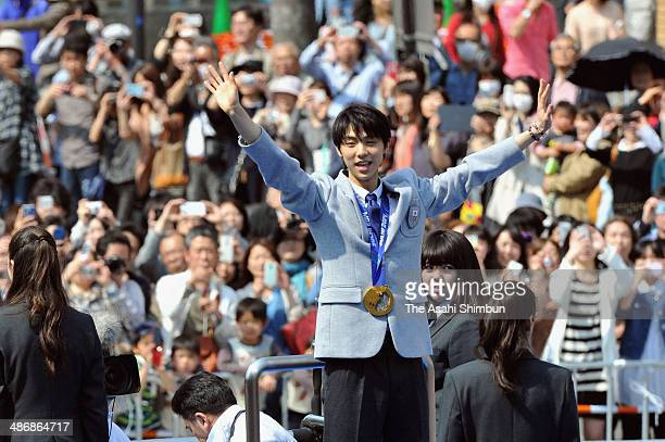 Sochi Olympics figure skating Men's Singles gold medalist Yuzuru Hanyu waves during his gold medal parade on April 26 2014 in Sendai Miyagi Japan...