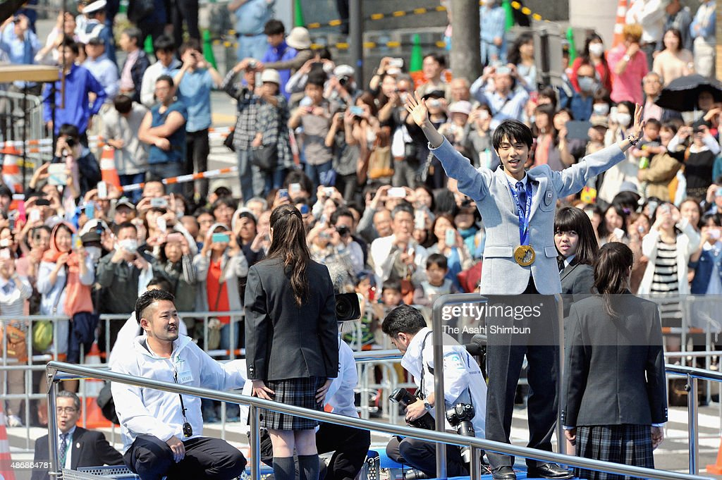 Sochi Olympics figure skating Men's Singles gold medalist Yuzuru Hanyu waves during his gold medal parade on April 26, 2014 in Sendai, Miyagi, Japan. 92,000 people celebrate the gold medalist.