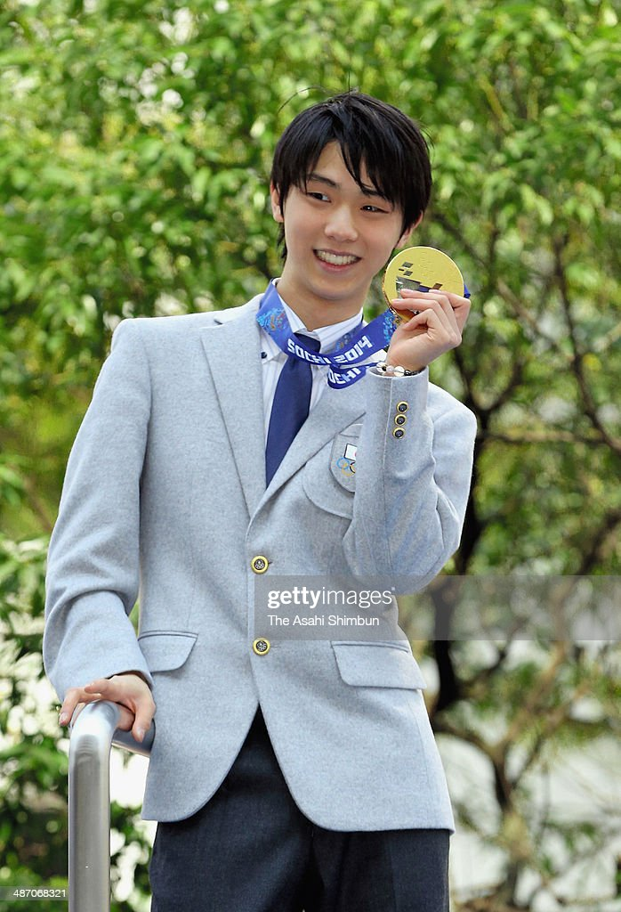 Sochi Olympics figure skating Men's Singles gold medalist Yuzuru Hanyu shows his medal during his gold medal parade on April 26, 2014 in Sendai, Miyagi, Japan.
