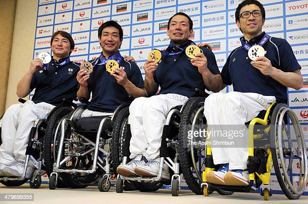 Sochi Paralympics medalists Taiki Morii Takeshi Suzuki Akira Kano and Kozo Kubo pose for photographs during a press conference at Narita...