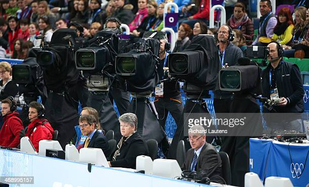 Sochi Russia February 12 SSOLY TV cameras draped in black are behind the judges moving in unison like the dancers they are filming At the Winter...