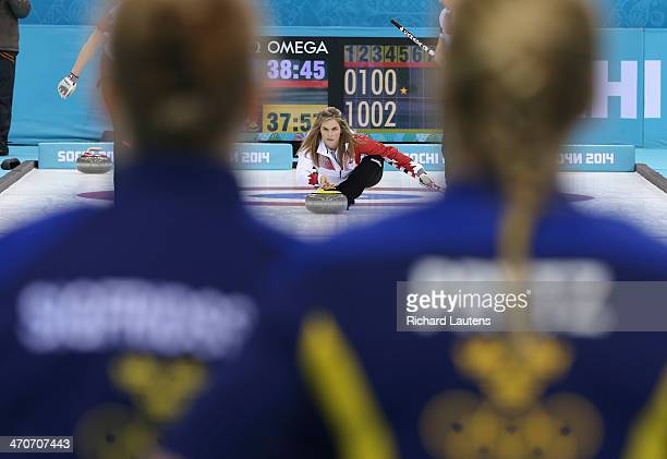 Sochi Russia February 20 SSOLY Canadian skip Jennifer Jones throws in the 5th as the Swedes look on At the Winter Olympics in Sochi the unbeaten...