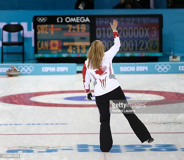 Sochi Russia February 20 SSOLY Canadian skip Jennifer Jones waves to the crowd as she heads down the ice to collect her broom At the Winter Olympics...