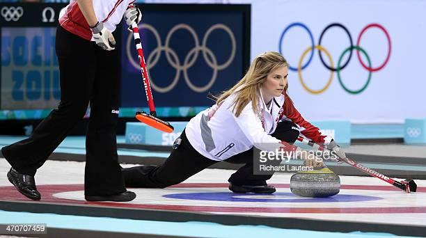 Sochi Russia February 20 SSOLY Skip Jennifer Jones throws as Jill Officer follows along At the Winter Olympics in Sochi the unbeaten Canadian women's...