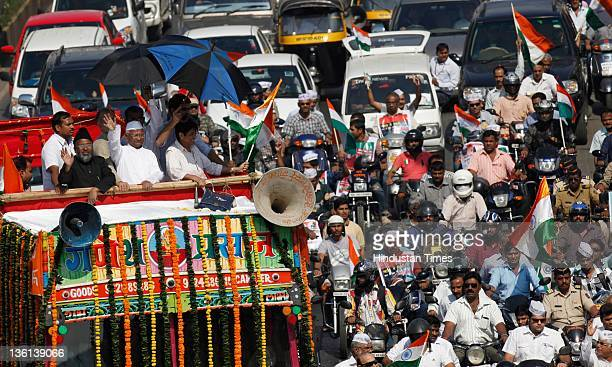 Social activist Anna Hazare and other supporters including with Kiran Bedi attend a rally on Bandra Western Express Highway en route to Mumbai...