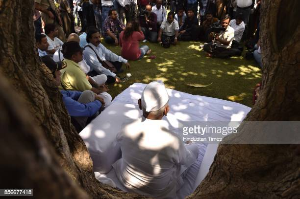 Social activist Anna Hazare sits on a daylong hunger strike for implementation of the Lokpal Bill protesting against the Modi government for 'doing...