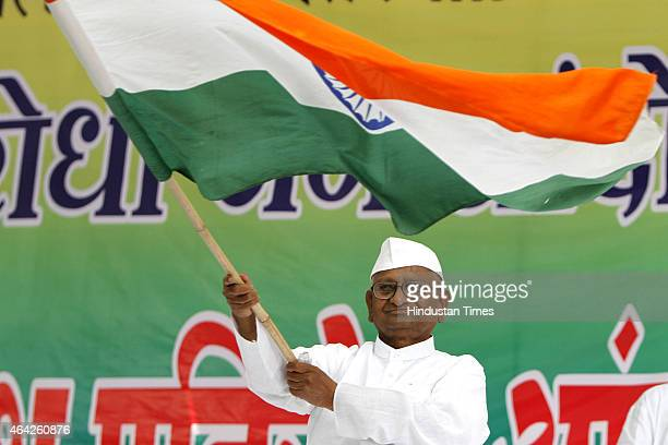 Social activist Anna Hazare waving the national flag during start of his twoday agitation against the land acquisition ordinance at Jantar Mantar on...
