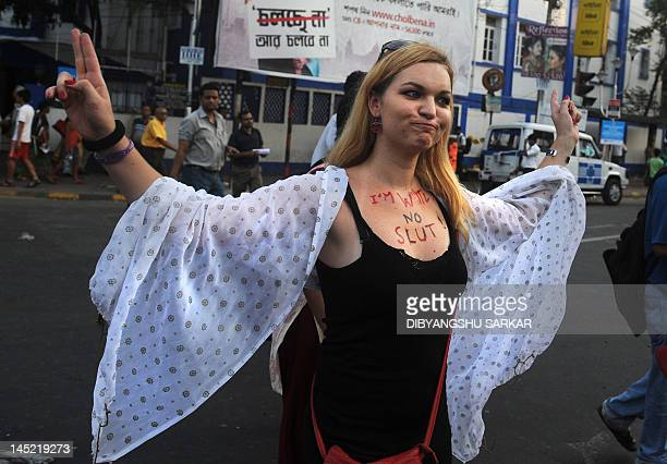 A social activist gestures as she participates in a Slut Walk in Kolkata on May 24 2012 Hundreds of supporters particiapted in the rally organised to...