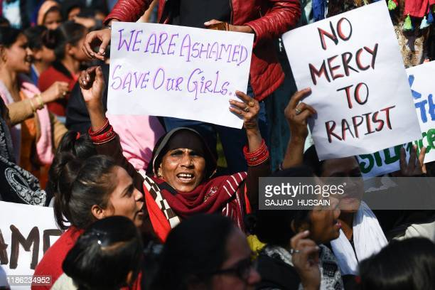 Social activists and supporters shout slogans to protest against the alleged rape and murder of a 27-year-old veterinary doctor in Hyderabad, during...