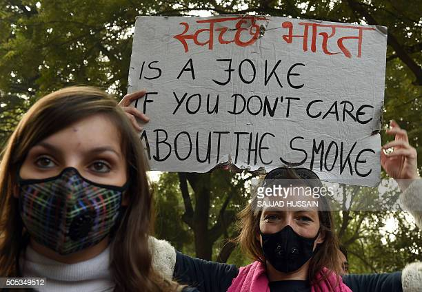 Social activists hold placards during an awareness rally against air pollution under the banner 'Help Delhi Breathe' in New Delhi on January 17 2016...