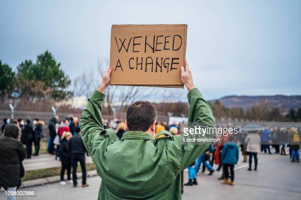 social activists protesting - revolution stock pictures, royalty-free photos & images