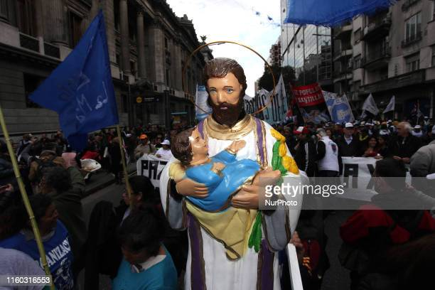 Social and political organizations march in protest during the religious festival of San Cayetano The organizations claim the government under the...