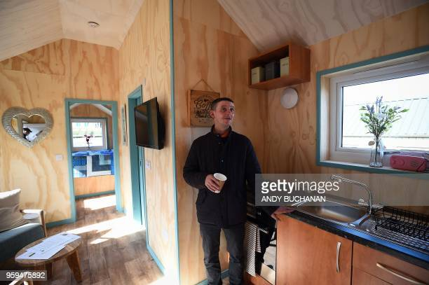 Social Bite worker Sonny Murray who was homeless has a look around the newly completed village buildings during the launch of the Social Bite Village...