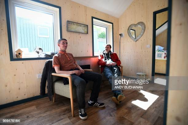 Social Bite workers Sonny Murray and Colin Childs who were homeless have a look around the newly completed village buildings during the launch of the...