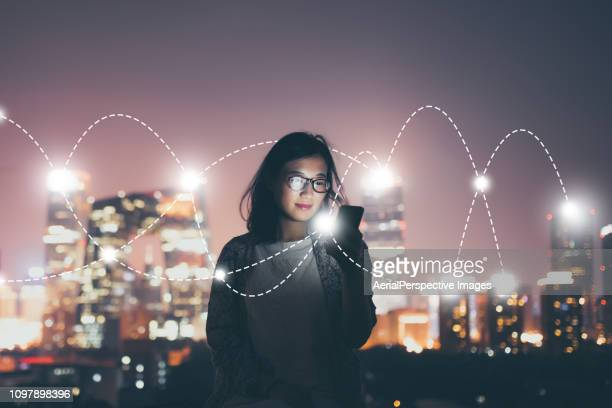 social connecting concept at night - wireless technology 個照片及圖片檔