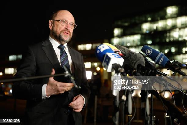 Social Democratic Party chairman Martin Schulz makes a statement as he arrives for a meeting with German Chancellor Angela Merkel and State Premier...