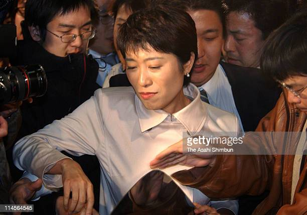 Social Democratic Party lawmaker Kiyomi Tsujimoto is seen upon departure after appearing on a television program at TBS headquarters on March 25 2002...