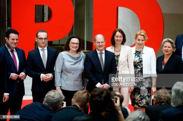 Social Democrats party leaders Andrea Nahles and Olaf Scholz pose next to designated Germann Labour Minister Hubertus Heil designated German Foreign...