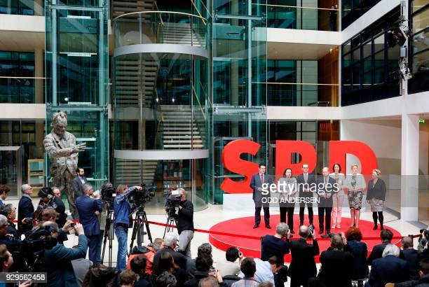 Social Democrats party leaders Andrea Nahles and Olaf Scholz stand next to designated Germann Labour Minister Hubertus Heil designated German Foreign...