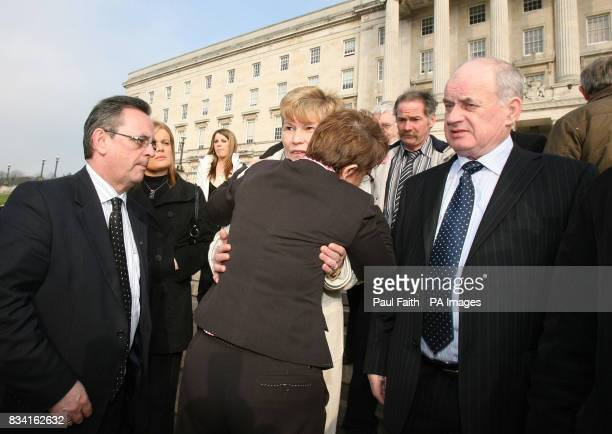 Social Development Minister Margaret Ritchie with SDLP Assembly member Dominic Bradley hugs Breige and Stephen Quinn whose son Paul Quinn was...