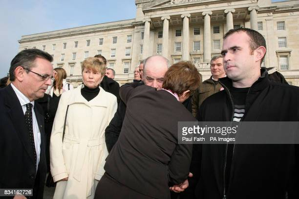 Social Development MinisterMargaret Ritchie with SDLP Assembly member Dominic Bradley hugs Stephen Quinnwhose son Paul Quinn was murdered in south...