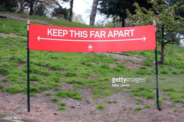 "Social distance guideline sign stating ""Keep This Far Apart"" is seen in Fort Greene Park on April 23, 2020 in the Clinton Hill neighborhood of the..."