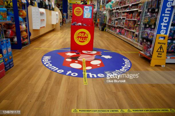 Social distance signage inside the Entertainer toy store on June 15, 2020 in Altrincham, United Kingdom. The British government have relaxed...