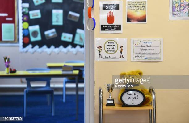 Social distance signs are displayed outside a classroom at Astbury St Mary's Church of England Primary School on March 02, 2021 in Congleton,...