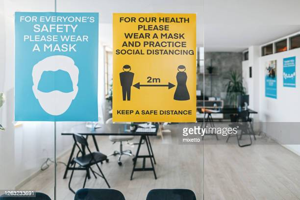 social distancing and coronavirus prevention message at bank - sign stock pictures, royalty-free photos & images
