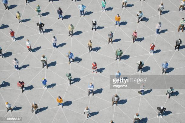 social distancing and networking - large group of people imagens e fotografias de stock