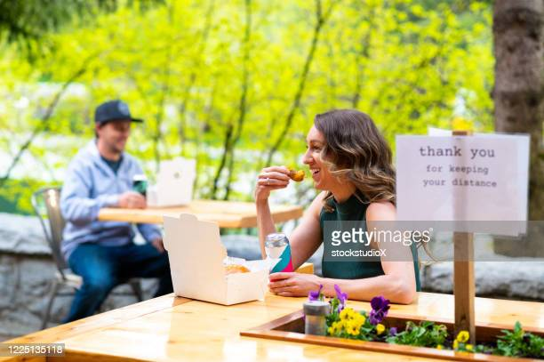 social distancing at a restaurant patio - social distancing stock pictures, royalty-free photos & images