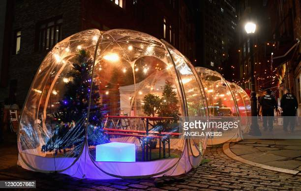 Social distancing bubble tents for dining are seen amid the Coronavirus pandemic on December 10, 2020 in New York City. - An expert committee...
