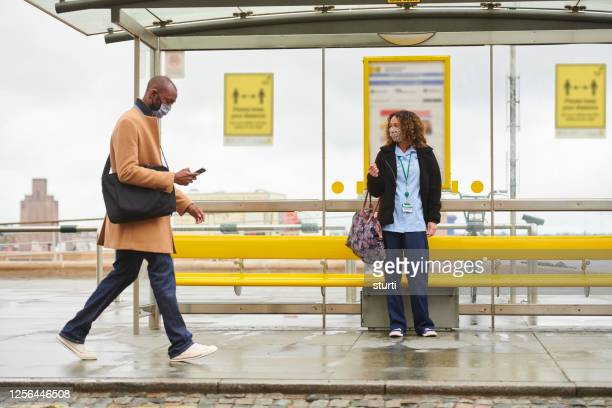 social distancing bus stop - sitting stock pictures, royalty-free photos & images